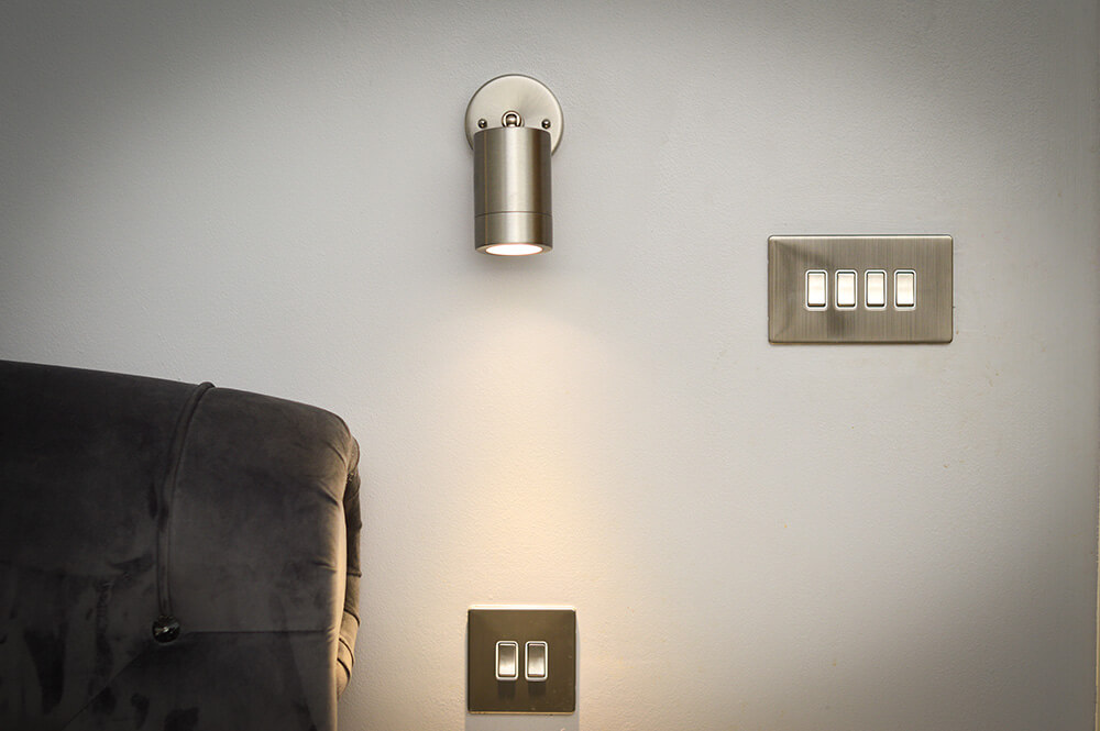 chrome-light-and-switches-in-bedroom