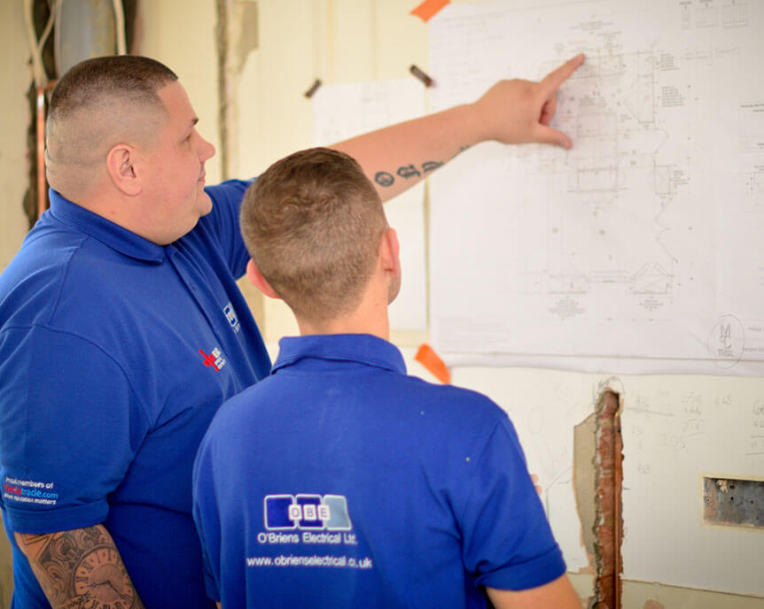 obriens-electrical-staff-looking-at-plans